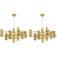 Pair of Brass Sciolari Geometric Chandeliers | From a unique collection of antique and modern chandeliers and pendants  at http://www.1stdibs.com/furniture/lighting/chandeliers-pendant-lights/