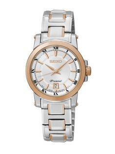 The Seiko women's Premier watch is crafted from a solid stainless steel case with a two-tone gold and silver stainless steel bracelet. The silvery-white dial houses a large date window at 6 o'clock and gold-tone arrow hands. Stainless Steel Watch, Stainless Steel Bracelet, Watch Model, Seiko Watches, Gold Watch, Watches For Men, Ladies Watches, Bracelet Watch, Jewelry Watches