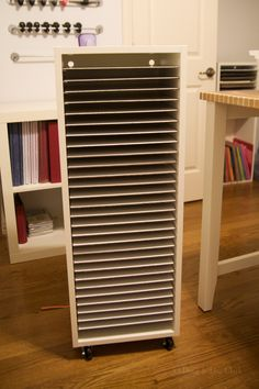 """My new paper storage. I bought an Ikea upper cabinet (size 15x39"""") base (item 443.832.10) for a shell for my storage solution. Then, I went to the hardware store and bought two 1/8""""x4'x8' panels. I purchased the cheapest white panelling they had, though they sell slightly more expensive and slightly thicker bead board in the same section. I had them cut each piece to 11 1/2""""x13 3/8"""". I was able to get 28 shelves out of one panel, which is exactly what was needed for this cabinet (I bough..."""