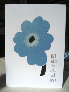 Text: The simply things in life is often nice. Unikko-flower from Marimekko, card made by Anna Jaawre.