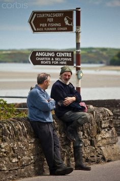 Locals chatting by the quayside at Courtmacsharry, County Cork, Ireland (2010)