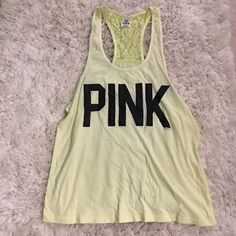 Neon yellow PINK tank Neon yellow razorback tank from pink. Lace on top (see picture). Willing to negotiate price! PINK Victoria's Secret Tops Tank Tops