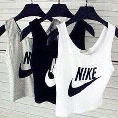 Nike top. White, black and grey, perfect with high-waisted trousers.