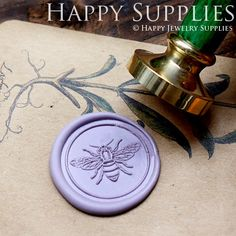 Love this bee seal stamp. https://www.etsy.com/listing/157722543/1pcs-bee-gold-plated-wax-seal-stamp