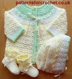 Three piece pram set free baby crochet pattern from http://www.patternsforcrochet.co.uk/baby-coat-hat-booties-usa.html #patternsforcrochet #freebabycrochetpatterns