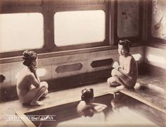 Hakone, 1890's. Three Women Taking a Bath.  Two women are squatting next to a bath, while a third sits in the water. This is the same gorgeous onsen resort in Hakone as shown in Hakone 1880s • Two Women in Bathroom.