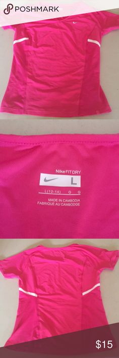 Women's Pink Nike Fit Dry Top Size L large 12/14 Women's Pink and white Nike Fit Dry Top Size L large 12/14.  Shirt is wrinkled from bring stored.  Refer to photos to View condition.  Note I cannot model this as it is not my size.  From a smoke free home. Nike Tops Tees - Short Sleeve