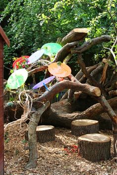 Social area or outdoor classroom enclosed in an oak tree den with oak seating; a magical place for children to reflect, refine and process their ideas and learning.