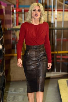 Ashley Roberts in a red top and black leather skirt