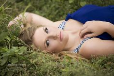 Love those blue eyes! Senior portraits. Laying down senior pose. www.audreyperez.com