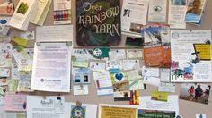 The community board at Over the Rainbow Yarn, where we invite the public to pin actual paper to an actual board!