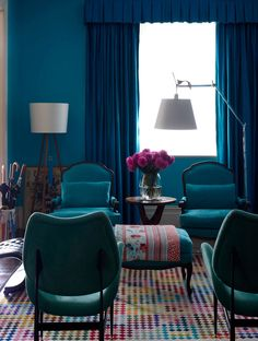 eclectic-living-room jewel color family room turquoise walls multi color pattern carpet design dark blue navy velvet sofa chairs