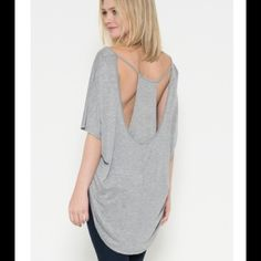 "Layered Back Top in Heather Grey Layered Back Top in Heather Grey. Available in Small, Medium, and Large. Brand new from LA Fashion District. 100% Rayon. Measurements*:  Small: 20"" Length (from neckline) 20"" Bust  Medium: 20"" Length (from neckline) 20.5"" Bust  Large: 20.5"" Length (from neckline) 22"" Bust   *Note: As with all retail clothing, measurements may vary up to 1/2 inch from item to item. Tops"
