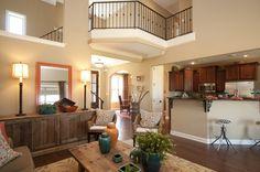 Regency Homebuilders : Open Concept Living, Neutral, Pops of Color, Blue, Orange, Open Concept Kitchen, Hand Scraped Wood Floors, Built In, Corner Fireplace {Laurel Tree Subdivision - Emmerson Plan}