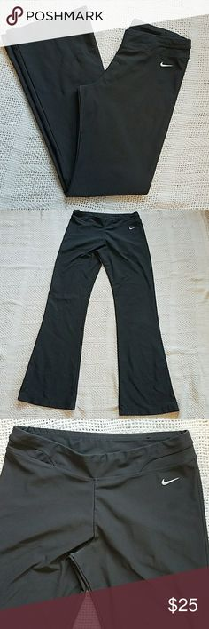 Nike charcoal flare leg athletic pants These pants have been worn but are in excellent condition. They are a Dri-Fit material. Nike Pants