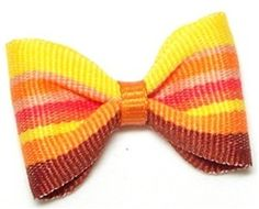 Top your pet's holiday outfit off with this Pumpkin Pie Designer Barrette ($14) from the Posh Puppy Boutique.