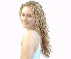long curly blond hair. from Curly Solutions Loose Curl gallery