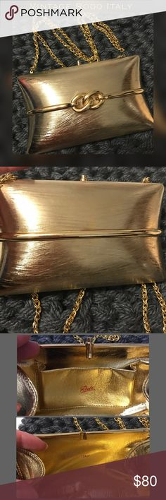 "🎉HP🎉Vintage Rodo Italy Gold Clutch with Chain Beautiful condition without any problems to the corners, chain or latch. It does have one little ding on the front left below middle(see top of pic 4) one pocket inside...I determined it vintage, as it's interior matches all the older bags(60's was what I was finding most)and today's Rodo bags have a stamped fabric interior. As shown in pic 4 can carry as a clutch with chain on inside or over shoulder. It measures 7""Wx4.5""H the strap is 21""…"