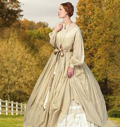 B5831  Misses dress year 1860. Size F5(16-24). MISSES' DRESS AND PETTICOAT: Dress has loose-fitting, lined, boned bodice, front extending to upper back, no shoulder seams, side back seams, gathered waist (by hand), inside ribbon, skirt front opening, bias, self piping, French seams, modesty sleeves, long sleeves with seam opening and button cuffs. Pleated petticoat has waistband and back opening. Purchased ribbon sash, trims and hoop.