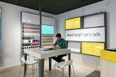 http://retaildesignblog.net/2013/12/11/argos-stores-by-dalziel-and-pow-london/