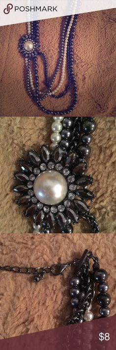 Beautiful pearl necklace Beautiful pearl necklace-4strands with a pearl accent piece. Jewelry Necklaces