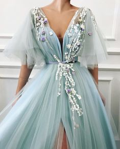 fcf38b686 Blooming Jardin. Details - Baby blue color - Tulle fabric - Handmade  embroidered flowers - Velvet belt - Ball-gown style