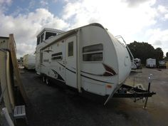 Used 2009 Keystone RV Outback Loft 27 LOFT Toy Hauler Travel Trailer at Sun Camper Liquidators | Fort Pierce, FL | #SCN-647