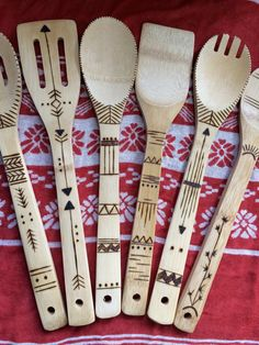 Wood Burned spoons by MandalaMaiden on Etsy. This is what I like use the shaft but stay off the working end if you can. I know the spoon bit the largest area but for me getting a design to work without compromising the working area is half the challenge ;)