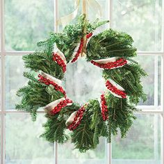 Cranberry Wreath | Wrap a wreath with a cranberry chain for contrast. | SouthernLiving.com