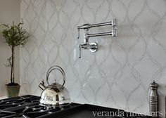 Interior Design Ideas The kitchen backsplash is a combination of mother of pearl and white thassos marble by Artistic Tile.  Veranda Estate Homes & Interiors.