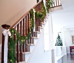 faux cedar garland on railing... love this look!