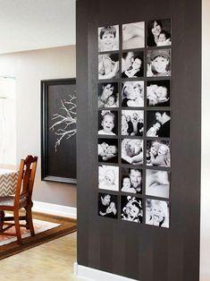 Chique verticale fotomuur op een zwarte muur. Mooie zwart-wit foto's zonder lijst.