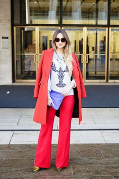 A lobster red suit with a lobster print sweatshirt - genius #streetstyle #NYFW #fashionweek