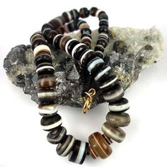 Knot worked collection of rare quality old suleimani agate beads. Each bead a masterpiece of old world bead craft.