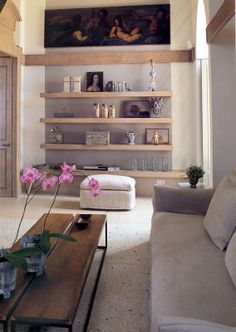 HORIZONTAL- DEFINITION: Makes a space feel wider, giving a restful feeling. WHY: The shelves, table and painting above the shelves all display horizontal lines.