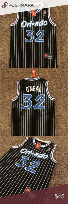 Nike #32 Shaquille O'Neal Orlando Magic Jersey Brand new #32 Shaquille O'Neal Jersey from Nike. Orlando Magic. Black with blue and black detail. Size large. Light material, good quality. Ships fast! Nike Shirts Tank Tops