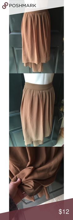 "✨ Gorgeous Brown Chiffon High-Low Maxi Skirt F21 - Gorgeous Brown Chiffon High-Low Skirt from F21 - Really awesome chiffon feeling material (100% polyester on tag) skirt from forever 21 - Gorgeous light brown color perfect to pair with any color! Dress up for going out or down for work  - High low but not significant difference, about 6"" between them - Slip underneath, zipper in back  - Purchased and never worn  - Brand: Forever 21 - Size: L  *20% off 2+ * Make me an offer!! Forever 21…"