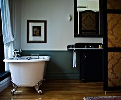 Iconic clawfoot tub, wood floors, and clean lines in this upscale bathroom in The NoMad Hotel in New York City, Remodelista