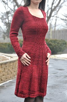 I like the transition from bodice to skirt. Very pretty design. Ravelry: jettshin's 2.Cabletta Wannabe-GRADUATION DRESS-Test knit