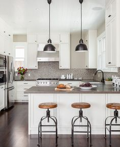 Industrial inspired kitchen - love the cabinets and backsplash, plus the island!