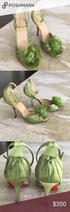 Christian Louboutin Rosazissimo feather sandal Gorgeous green Louboutin ankle strap sandal with feather detail.  Only worn a few times.  100mm heel. Satin material.  A beautiful statement heel.  Comes with original box and dusters. Christian Louboutin Shoes Sandals