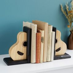 """Acoustic Guitar Bookends Walter Alexander handcrafted designs have a signature """"serial number"""" like you'd find inside a real guitar."""