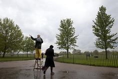 A lone Christian preacher gets ready to deliver his sermon as his assistant holds a prayer book at a wet and empty Speakers Corner in Hyde Park in central London, Sunday.    Alastair Grant/AP