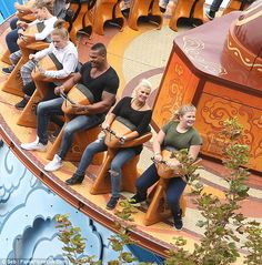 Riding high! Kerry Katona and fiancé George Kay indulge on a fun-filled family day out at Blackpool Pleasure Beach after pre-wedding bust-up