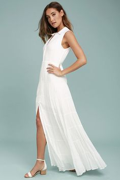 Cruise on over to seventh heaven on the Cloud Rider White Maxi Dress! A collared neckline tops this lightweight, woven maxi dress with a sleeveless bodice, button-up front, and tiered maxi skirt with front slit.