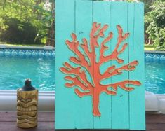This beachy piece of art is made from reclaimed wood and would be perfect for a nautical inspired beach house! Each sign is hand cut, hand sanded and hand painted. Each sign is made to order so no two will be exactly alike due to variations in the wood. All signs have cable wire on the back for easy hanging. Dimensions are approximately 36x 21 inches.