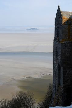 View of the sand (and quicksand) that surrounds Mont St. Michel - walked the complete circuit around the island when the tide was out - magnificent view looking up!