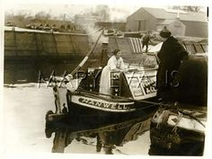 Ray Strachey (nee Rachel Costelloe, 1887-1940), British novelist and suffrage campaigner. Seen here electioneering in Chiswick and Brentford, West London. She is talking from the quayside to a woman on board a barge named Hanwell.