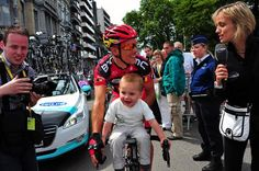 Maybe not the safest way to ride with your son, but he does look like he is having fun.  (Philippe Gilbert of BMC)