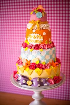 Colorful Wedding Cake----don't care for the total look of this cake, but like some of the individual ideas